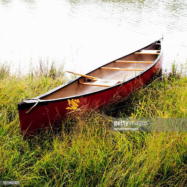Red Canoe by Lake