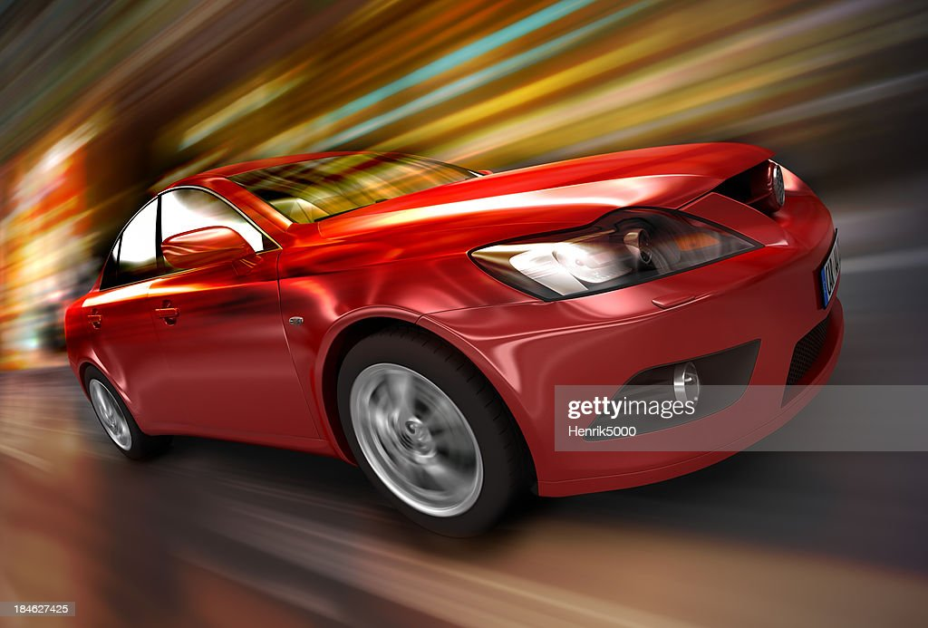 Red car driving fast : Stock Photo