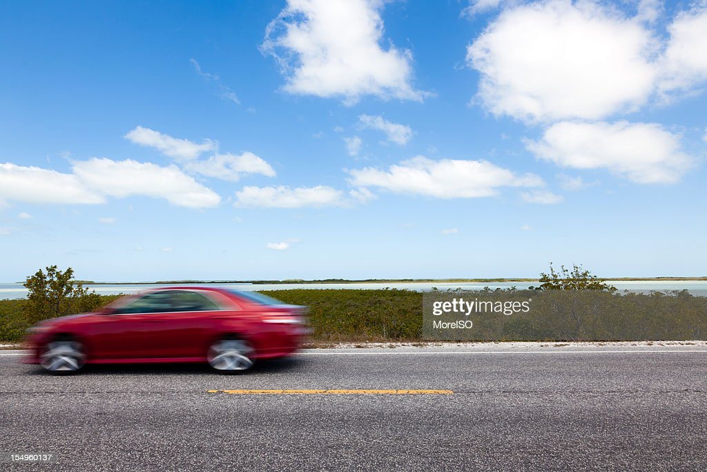 Red Car Driving in the Florida Keys