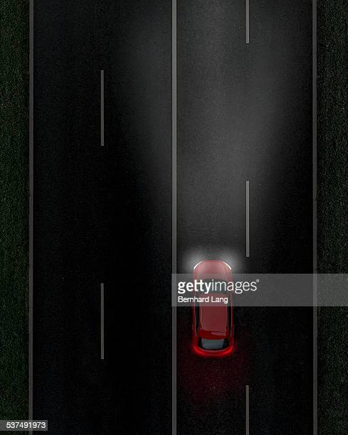 Red car on street by night, Aerial View