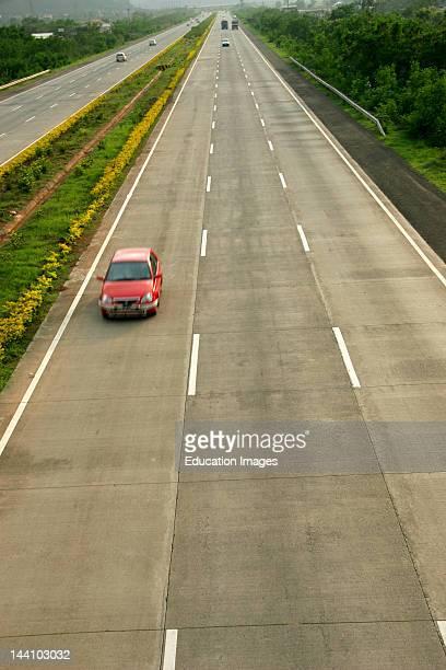 Red Car Speeding On Mumbai Pune Expressway Malavli Lonavala Maharashtra India