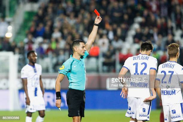 Red card for Mathieu Deplagne of Troyes and Karim Abed referee during the Ligue 1 match between Metz and Troyes AC at on September 23 2017 in Metz...
