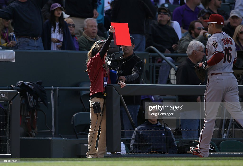 A red card is displayed on the field as the Arizona Diamondbacks face the Colorado Rockies during the home opener at Coors Field on April 4, 2014 in Denver, Colorado. The Rockies defeated the Diamondbacks 12-2.