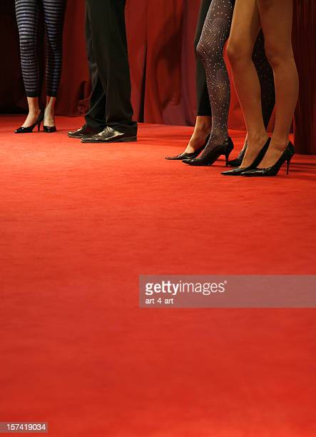 Red carpet catwalk with fashion models legs