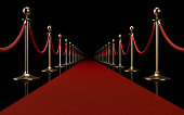 Red carpet on black background. Horizontal composition with copy space. Great use for red carpet related concepts.