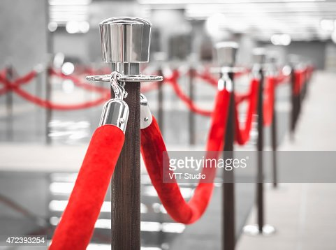 Red Carpet Fence pole with Blurred interior background : Stock Photo