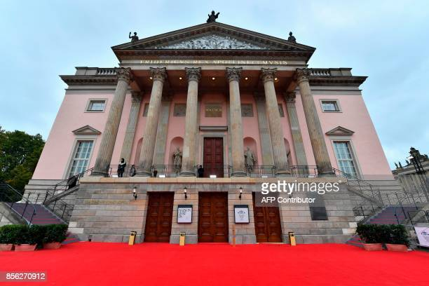 A red carpet is layed in front of Berlin's Staatsoper on October 1 prior to its official reopening on October 3 after a 7year renovation that cost...