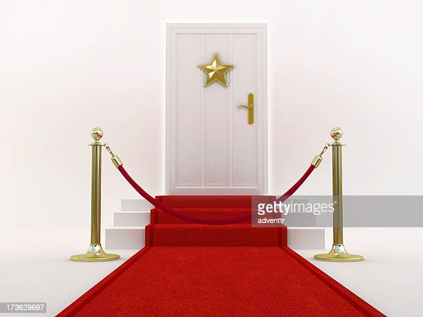 Red carpet leading to the door with star shape