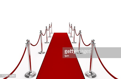 A red carpet with red rope and poles