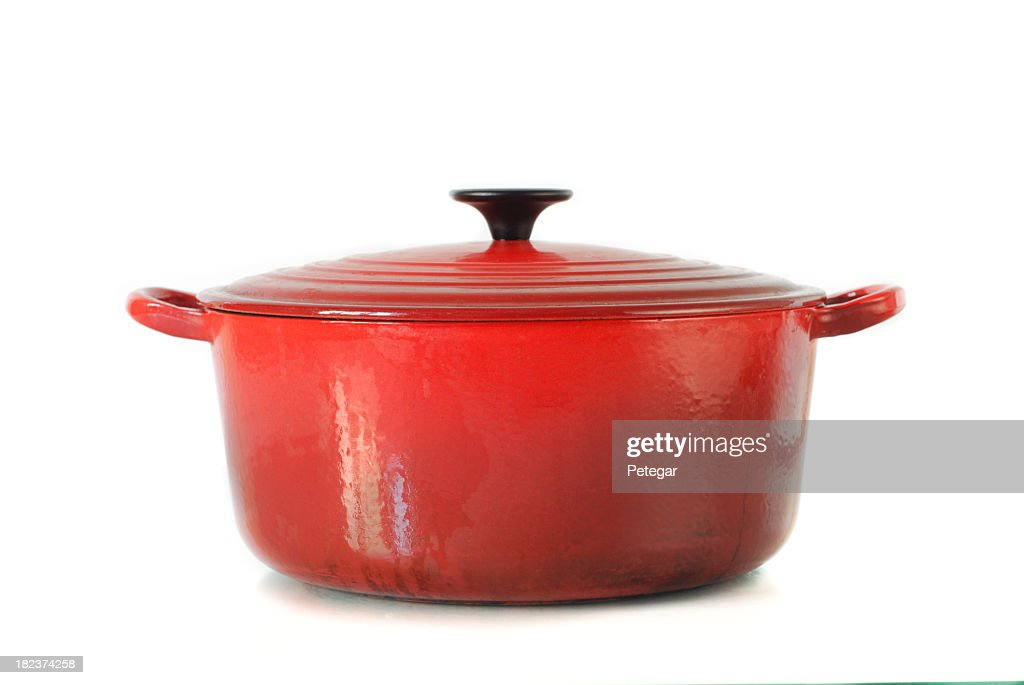 Red casserole dish on white background