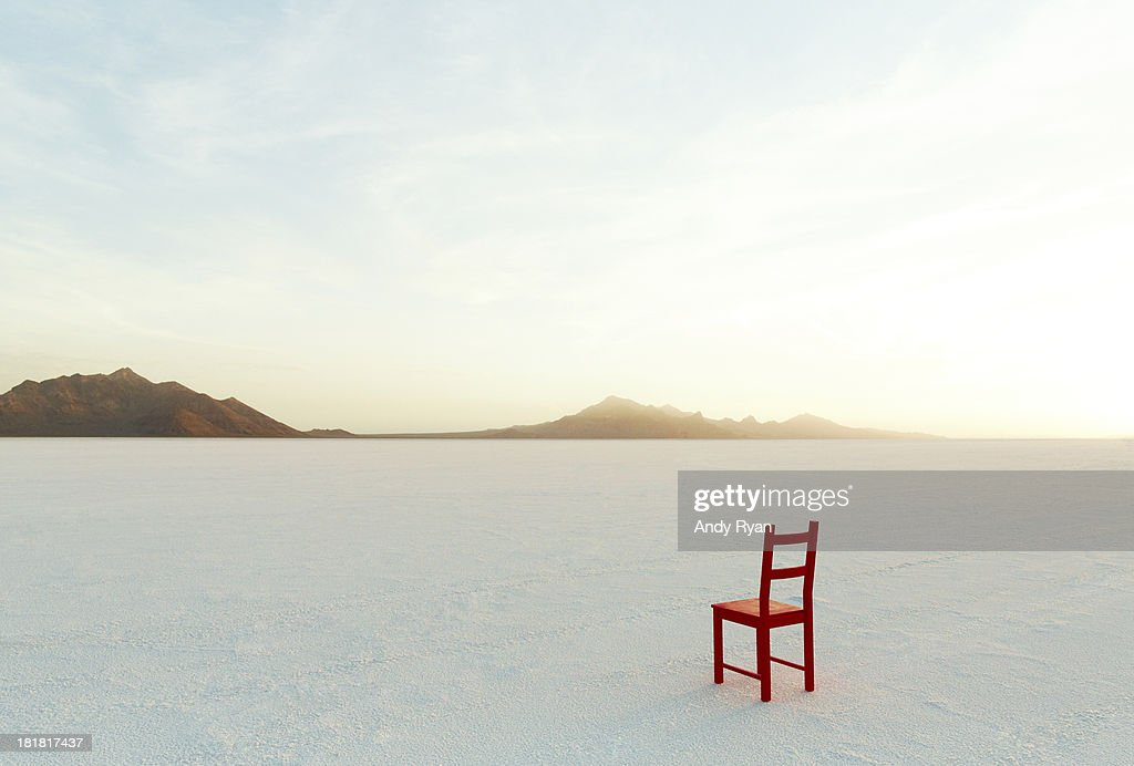 Red Chair on salt flats, facing the distance