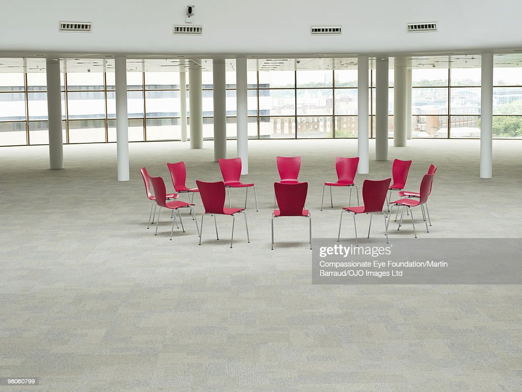 red chairs arranged in a circle : Stock Photo