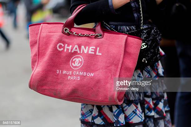 A red Chanel bag outside Chanel during Paris Fashion Week Haute Couture F/W 2016/2017 on July 5 2016 in Paris France