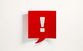 Red chat bubble with exclamation point on white background. Horizontal composition with clipping path and copy space.