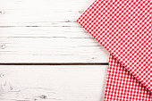 red checkered tablecloth on a white wooden board
