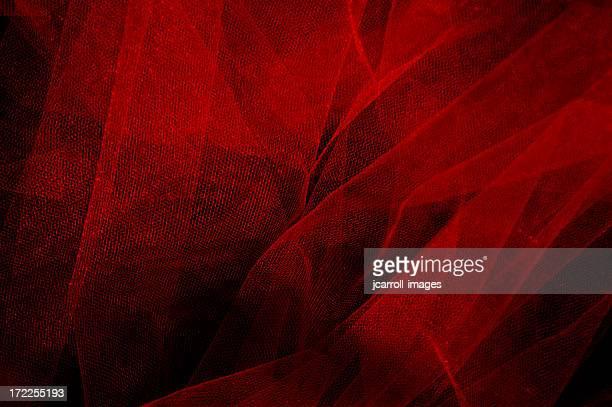 Red chiffon on a black background