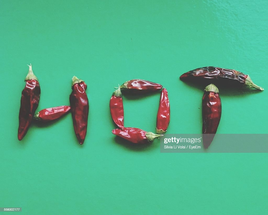 Red Chili Peppers Arranged In Shape Of Word Hot