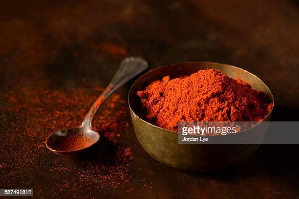 Red chili powder in brass vintage bowl