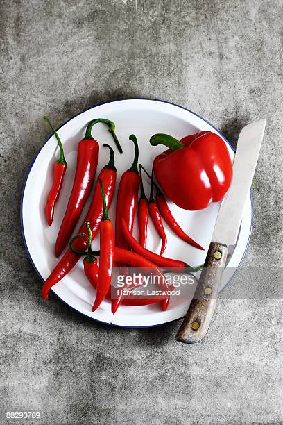 red chillies and peppers on white plate