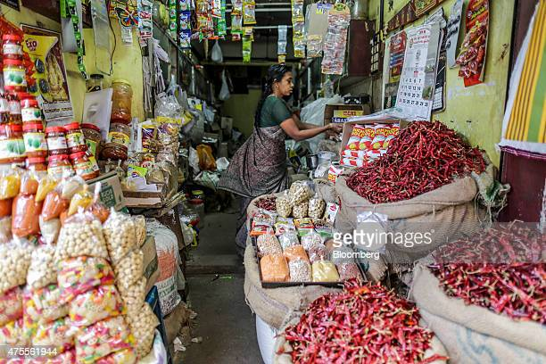 Red chillies right and other spices sit on display at a store in Thiruvananthapuram Kerela India on Sunday May 31 2015 While consumerprice gains...