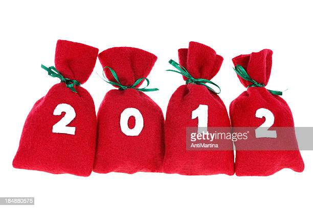 red Christmas bags (year 2012) isolated on white