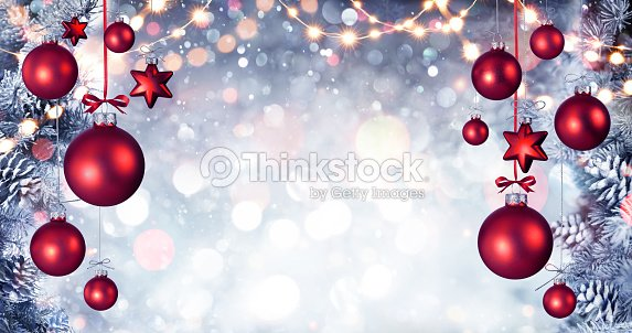 Red Christmas Balls Hanging With Snowy Fir branches And String Lights : Stock Photo