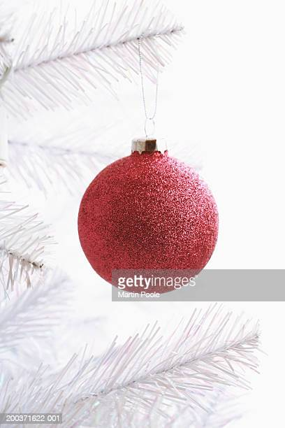 Red Christmas bauble on Christmas tree, close up