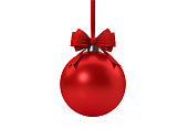 Red Christmas bauble tied with red velvet ribbon over white background. Clipping path included. Horizontal composition with copy space. Great use for Christmas related concepts.
