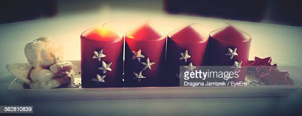 Red Christmas Candles With Cupid Statue In Tray