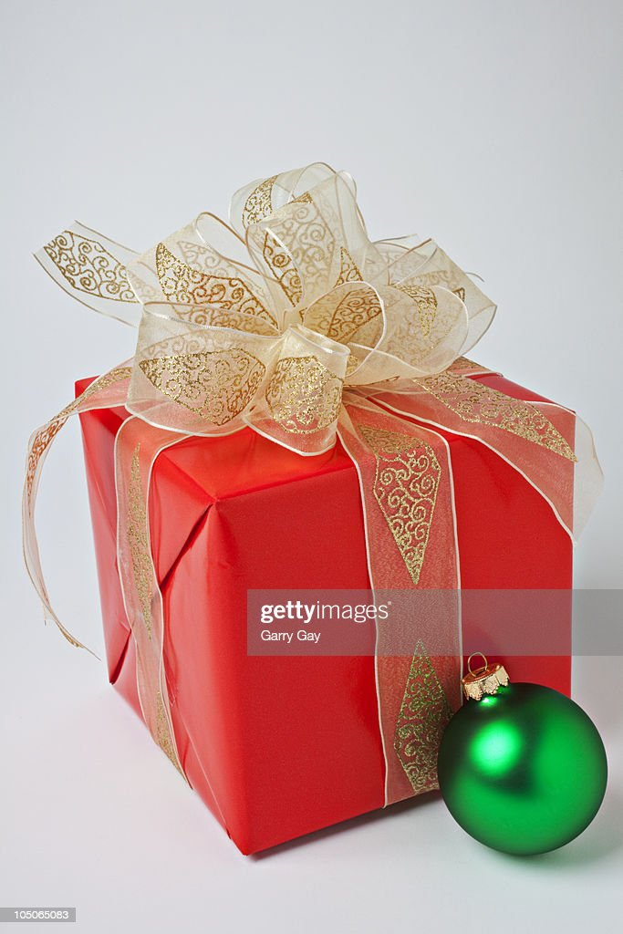 Red Christmas gift box with green ornament : Stock Photo