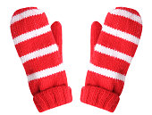 Red white christmas pair gloves isolated.Winter fashion mittens.