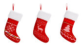 Red christmas stockings with patterns isolated over white 3d rendering