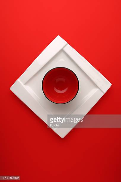 Red circle bowl on white square plate