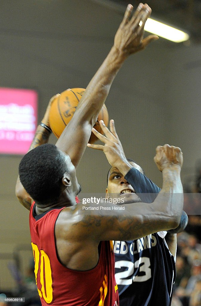 Red Claws #23, Romero Osby shoots two from the key over Mad Ants #20, Marcus Simmons as the Maine Red Claws host Fort Wayne Mad Ants in playoff action at the Expo..