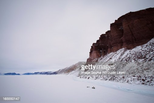 Red cliffs in snowy landscape : Stock Photo