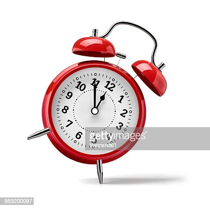 Red clock in front of white background