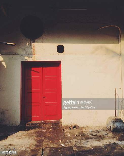 Red Closed Door Of House