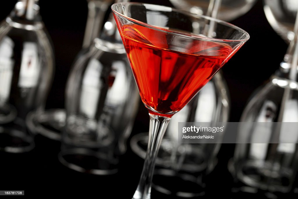 Red cocktail in a martini glass : Stock Photo