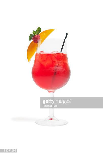 A red cocktail with peach and raspberry