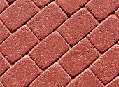 Red color cobblestone pavement surface. abstract background and texture for design.