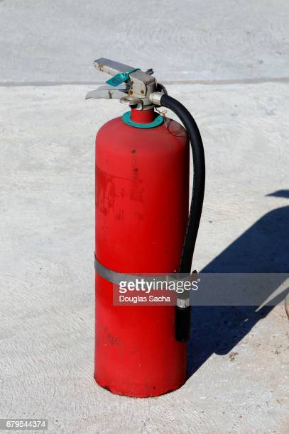 Red colored fire extinguisher
