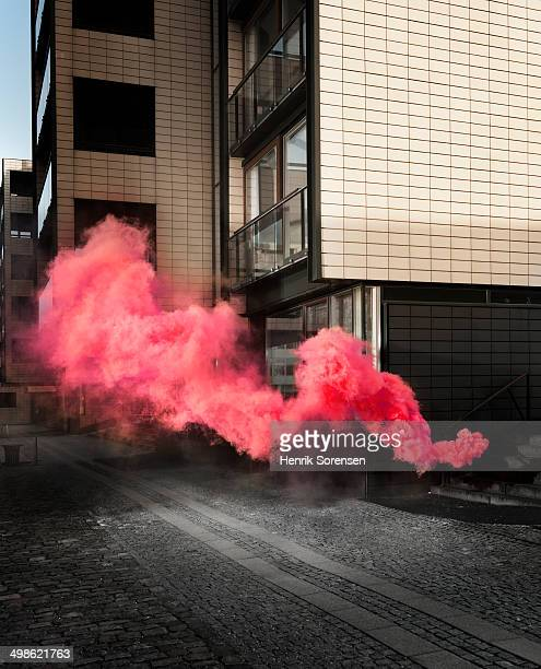 Red colored smoke in urban area