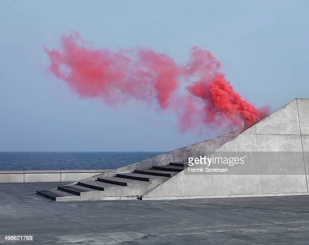 Red colored smoke near the seaside