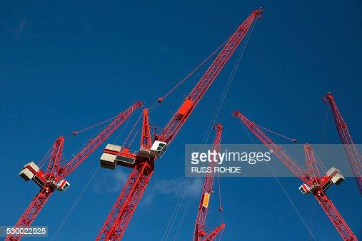 Red construction cranes