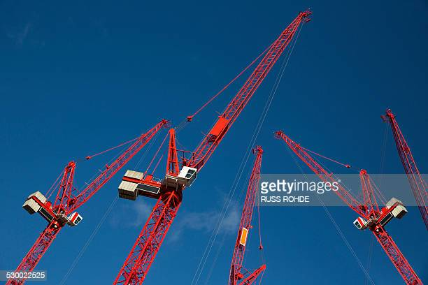 Red construction cranes
