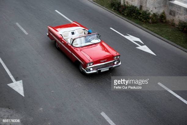 Red convertible vintage car axi at street of Prado Havana, Cuba