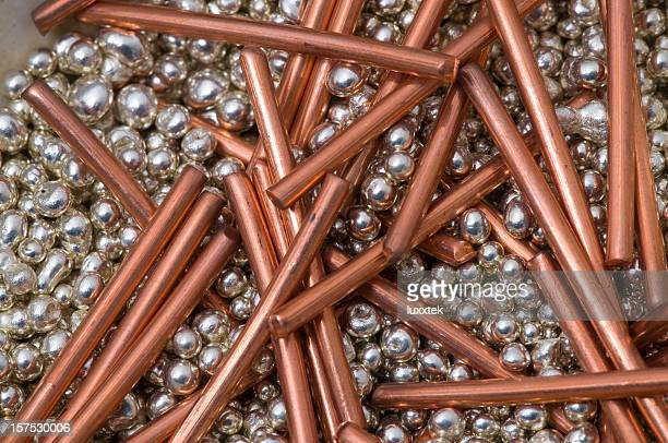 red copper and silver pellets
