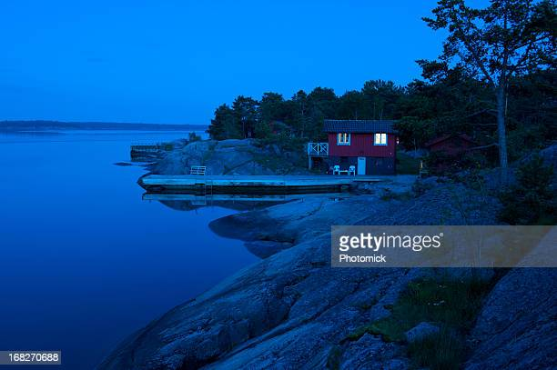 Red cottage in the archipelago just after sunset