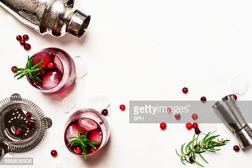 Red cranberry cocktail with ice, rosemary and vodka : Stock Photo