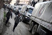 A Red Crescent convoy carrying humanitarian aid arrives in Kafr Batna in the rebelheld Eastern Ghouta area on the outskirts of the capital Damascus...